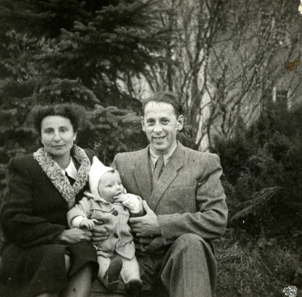 Emil and Elze Goldberg sit outside with their baby son Edwin (Eddy)