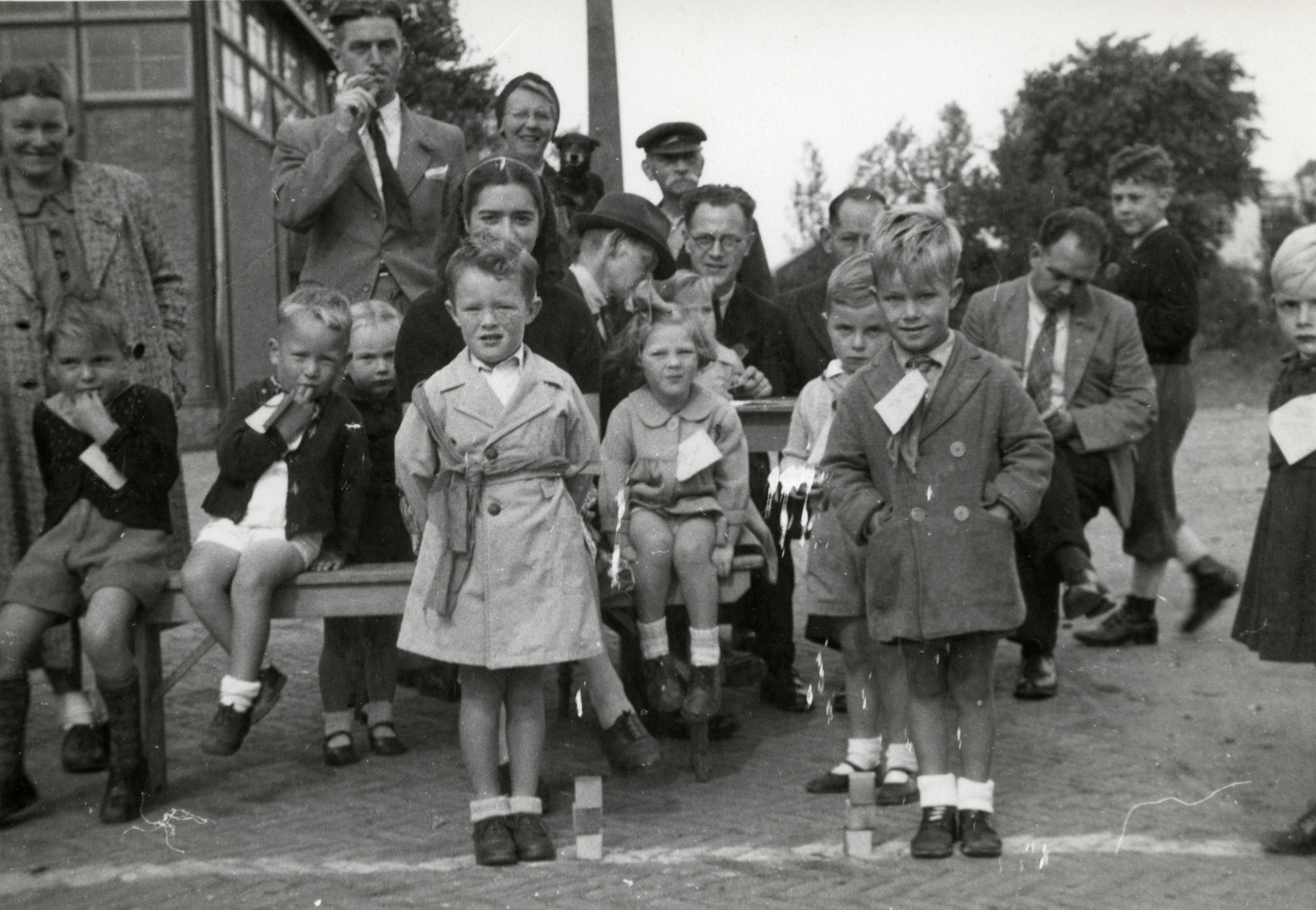 Residents of Dordrecht celebrate the liberation of their town.  Margalit Lujten is pictured partially obscured sitting behind a young child.