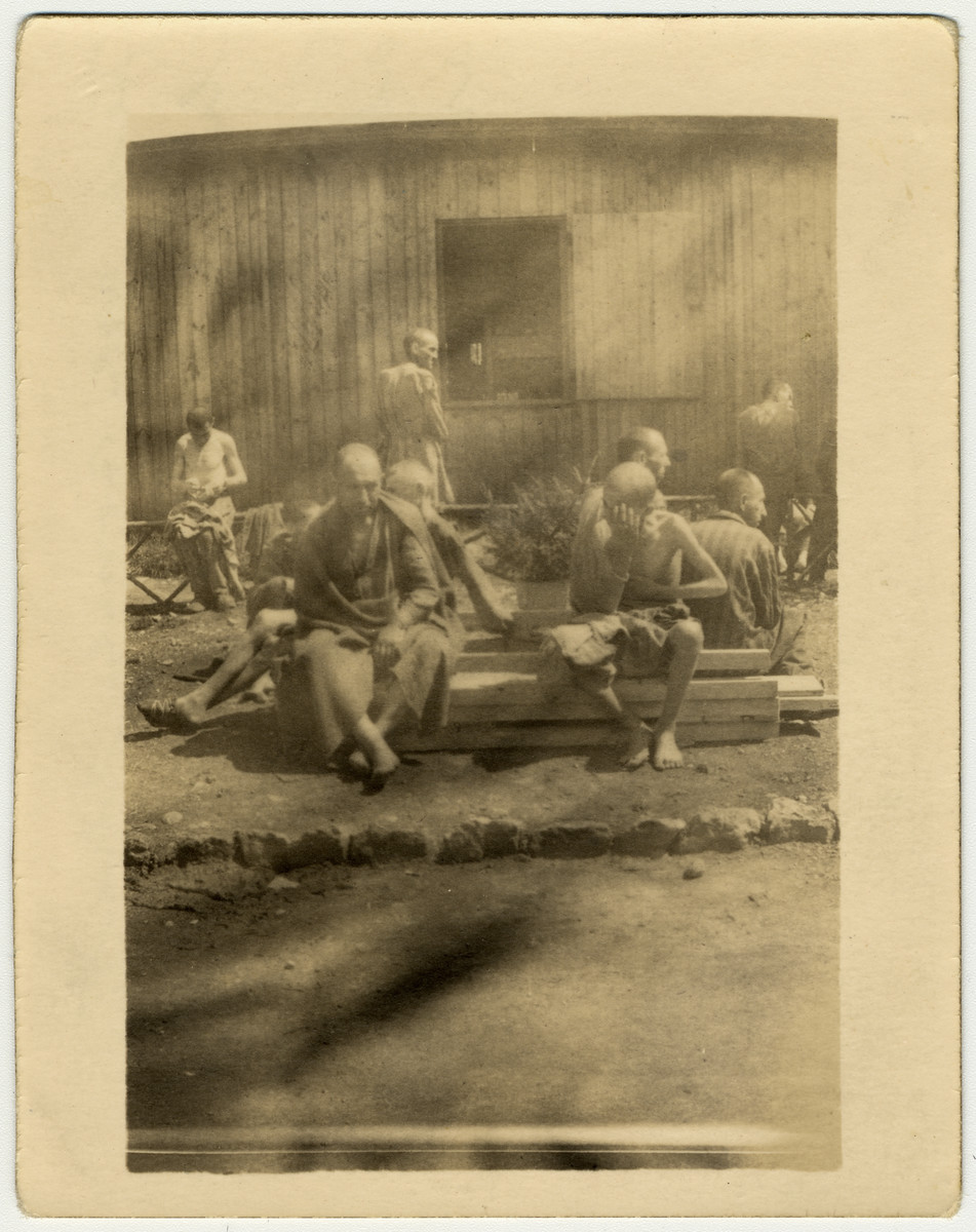 "Starving and diseased survivors sit outside a barrack of the Buchenwald concentration camp after liberation.  The original caption reads ""Here are some that lived through it, and I don't see how they did with all the diseases floating around."""