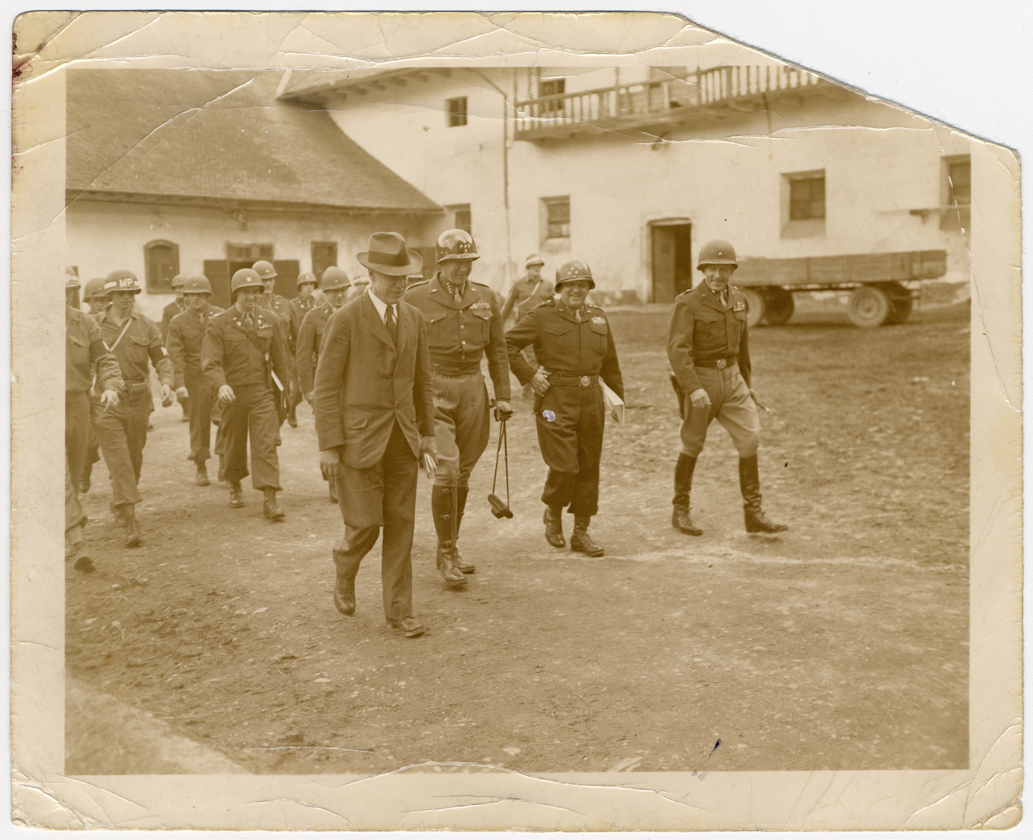 General Patton escorts Under Secretary for War, Robert Patterson, through a town in Austria.  Also pictured are Brig. General Collier and Lt. General Walker.