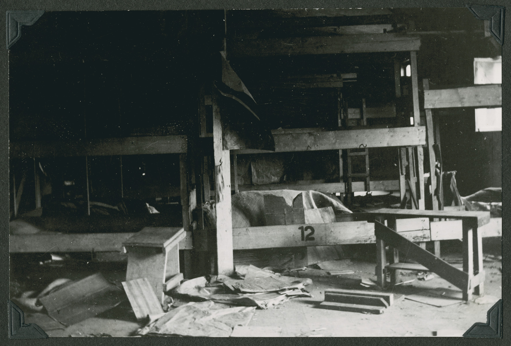 "View of an old three story bunk bed in the Ziegenhain displaced persons camp.  The original caption reads: ""What confronted the Jewish Displaced Persons when they were brought to Ziegenhain."""
