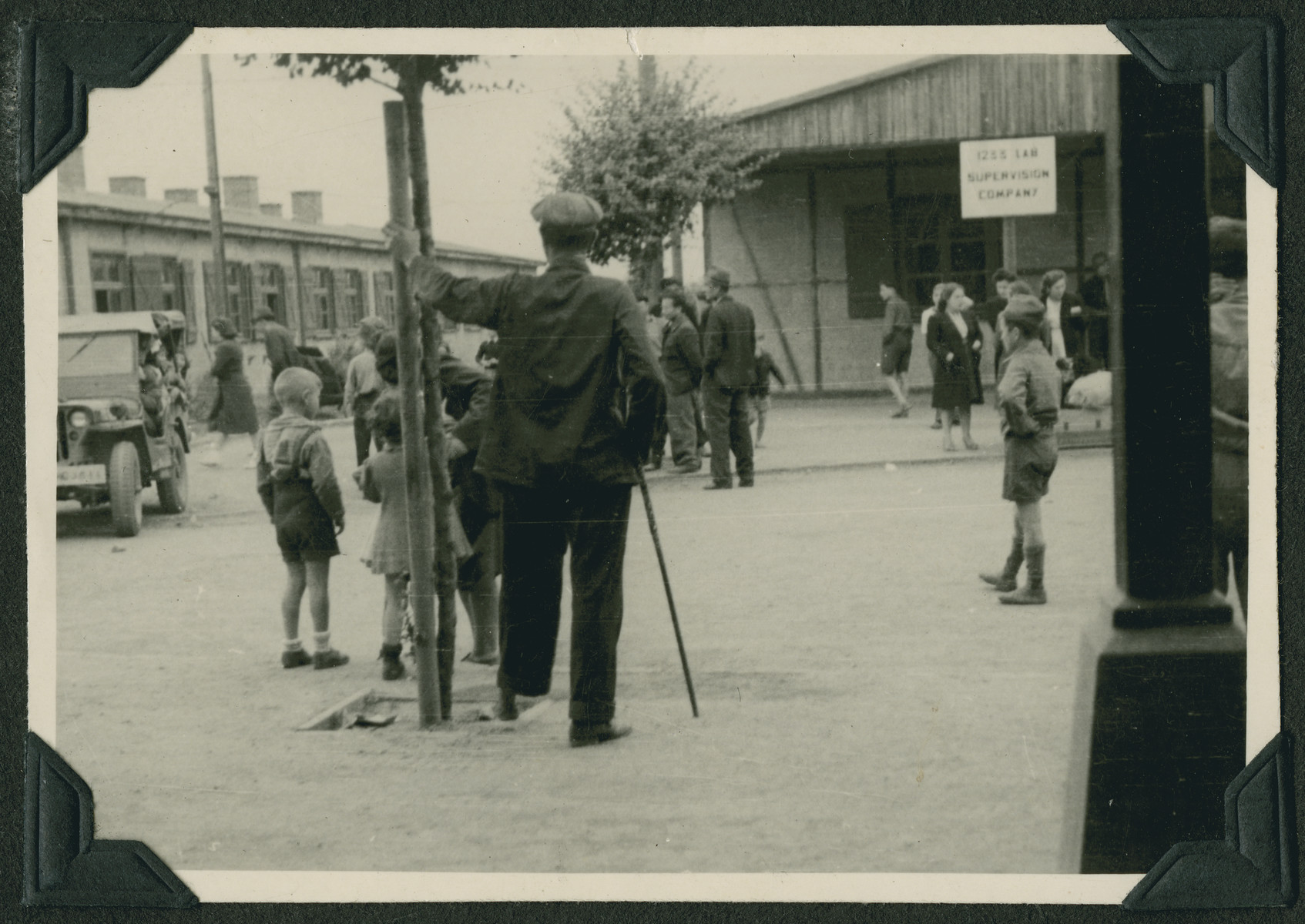 Children and adults gather on a street in the Ziegenhain displaced persons camp.