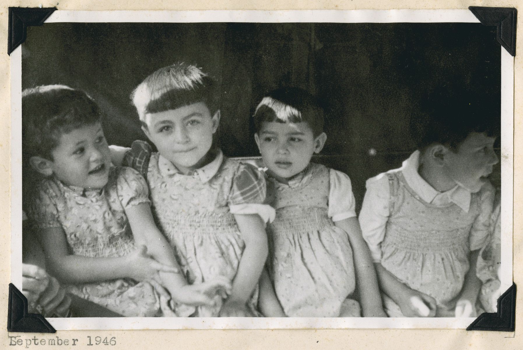"Close-up portrait of four young girls in the Lindenfels school.  The original caption reads: ""Lindenfels school: Their new climate and human attention are bound to show."""