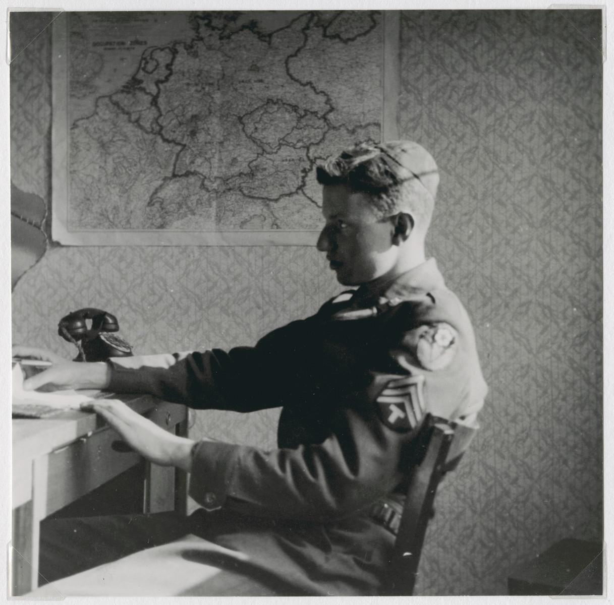 Eliezer Dembitz, a member of the Frankfurt Jewish GI Council, sits at his desk.