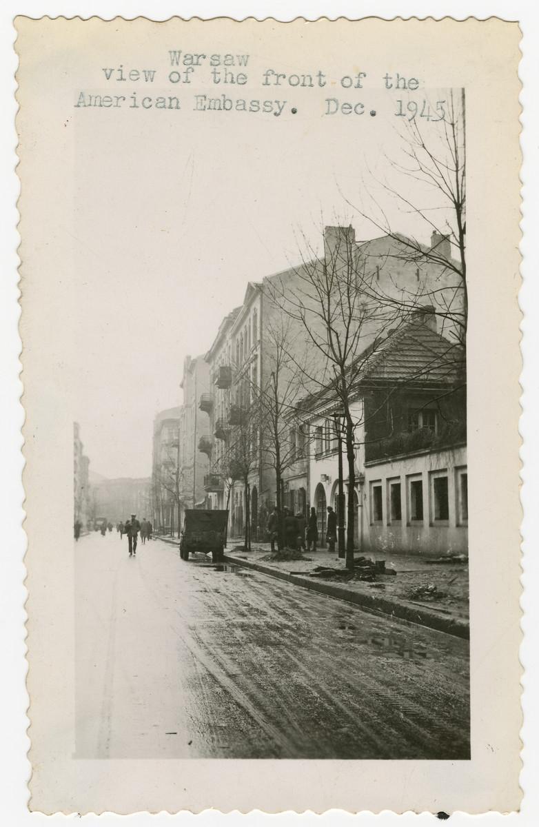 Street scene in postwar Warsaw in front of the American Embassy.