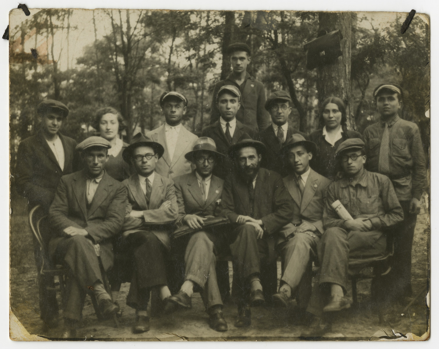 Asher Fetherhar (later Zidon) poses with members of the Hechalutz Mizrachi hachshara in Otwock.