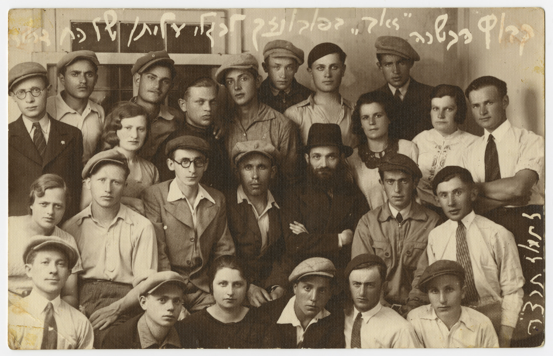 Asher Fetherhar (later Zidon) poses with members of the Hechalutz Mizrachi hachshara probably in Powazki.