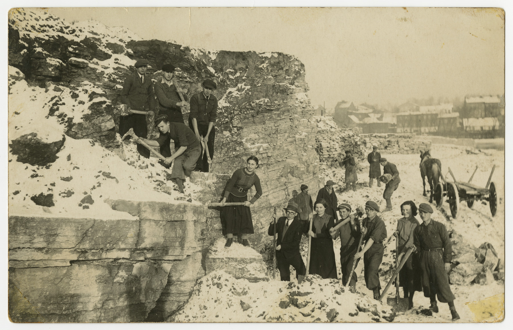 Asher Fetherhar (later Zidon) poses with members of the Hechalutz Mizrachi hachshara in Czeladz while working in a quarry.