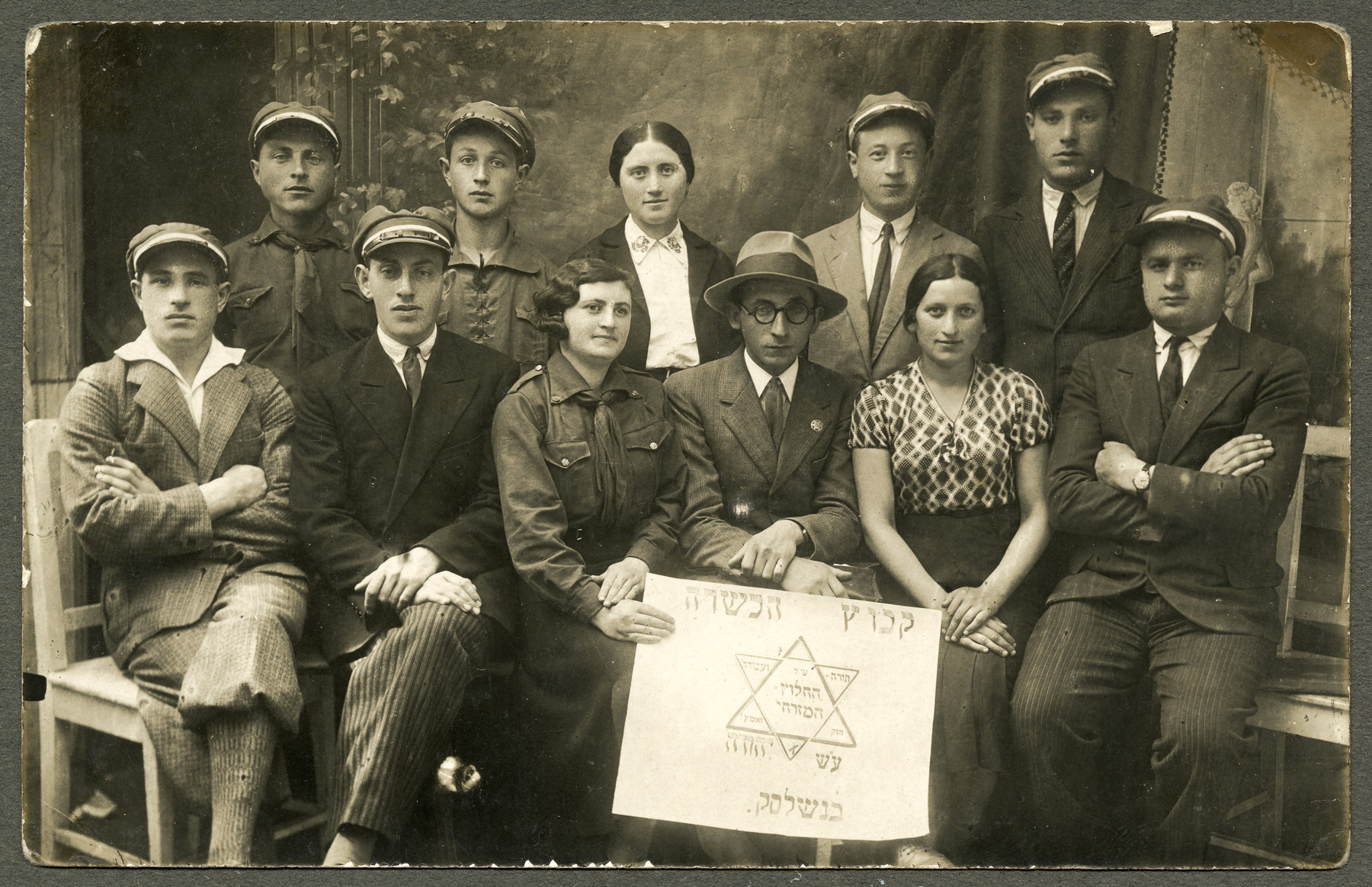 Asher Fetherhar (later Zidon) poses with members of the Hechalutz Mizrachi hachshara in Nasielsk.