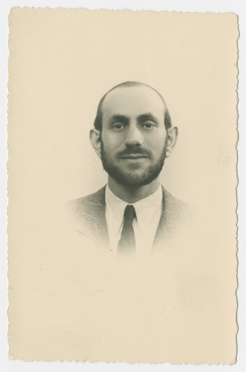 Studio portrait of Izak Stiel, probably taken for identification prior to his immigration to Canada.  He escaped Poland with the Kalb rescue mission.