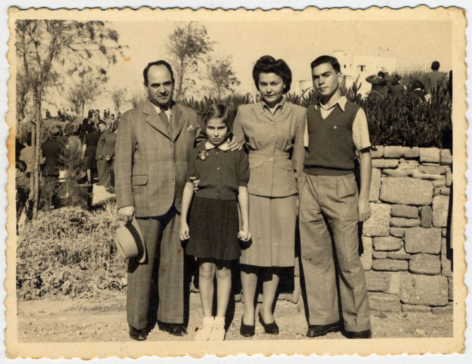 The Menn family poses by a stone wall in Tel Aviv where they settled after escaping from Lithuania.  Pictured from left to right are David, Bella, Regina and Julius Menn.