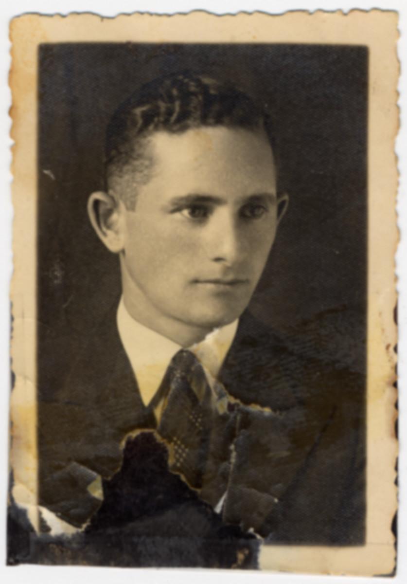 Studio portrait of Yaakov Luksenburg, a young man in Zwolen Poland, who later perished in Skarzysko Kamienna.