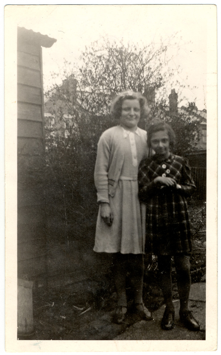 Ruth Danzig (right) from Munich and her cousin Bianca Bravmann (left), pose in Wittelshofen prior to leaving on a  Kindertransport,.  Bianca left Wittelshofen for Munich to attend school because the children in Wittelshofen threw stones at her since she was Jewish.  From there she left for England on a Kindertransport.