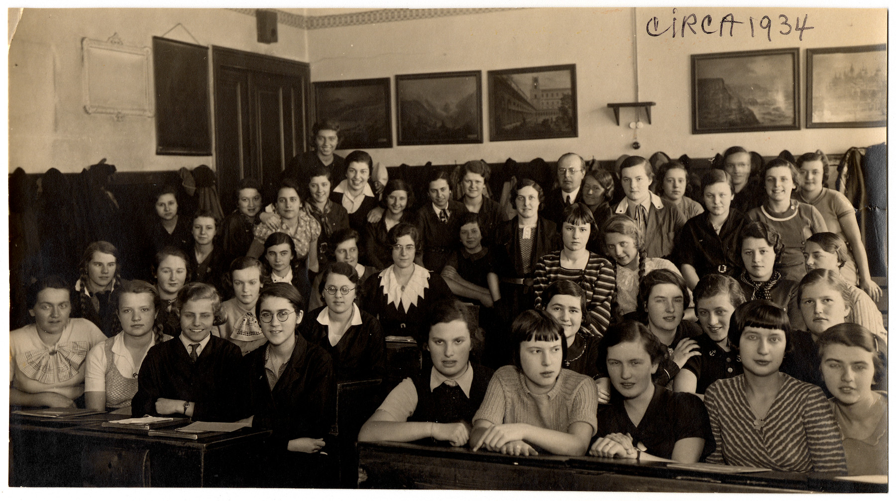 Portrait of a girls high school class in Vienna.  Hedi Politzer is pictured in the front row, third from the left.