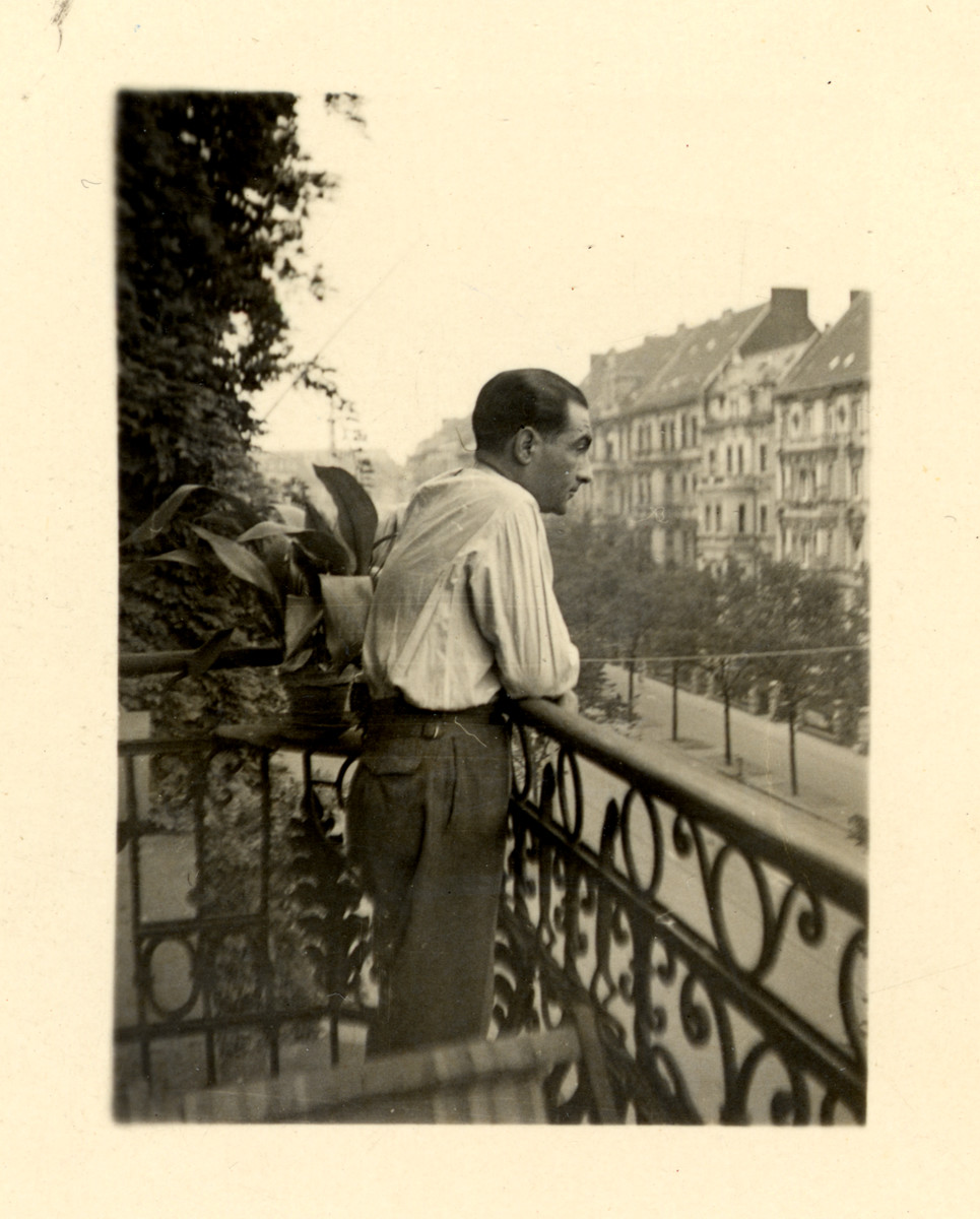 Berthold Marx looks out the balcony of his apartment in Berlin.