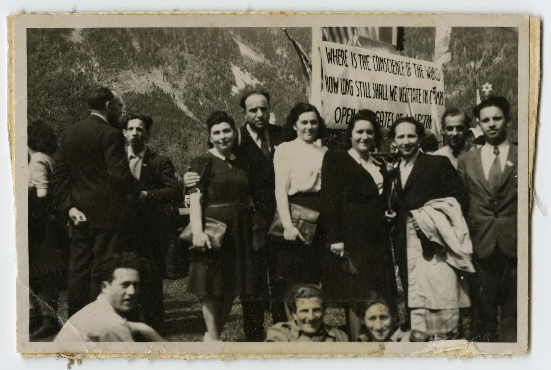 Displaced persons demonstrate against British immigration policy to Palestine in the Feldafing camp.  Jenta and Leib Szapiro are pictured fourth and third from the right.