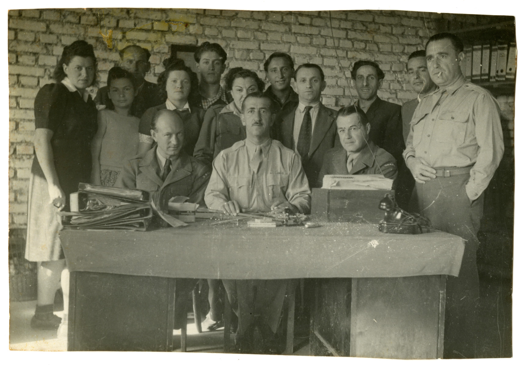 Administrative office of the Feldafing displaced persons camp.  Leib Szapiro is pictured third from the right.