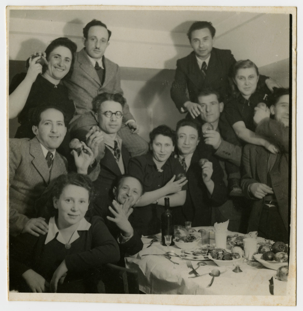 Jewish displaced persons gather for a celebration in Feldafing.  Leib and Jenta Szapiro are pictured on the far left.