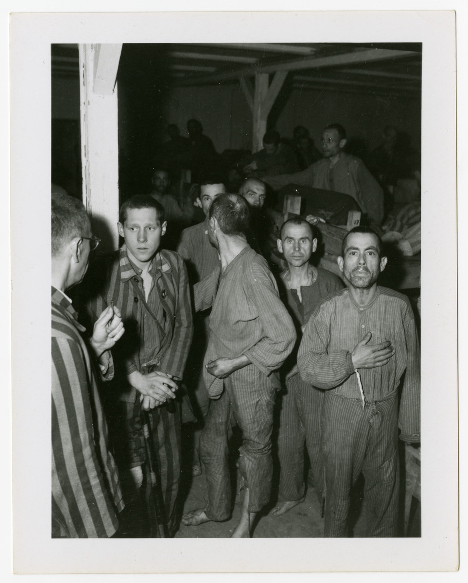 A group of survivors gather inside of a barrack in Langenstein-Zwieberge.