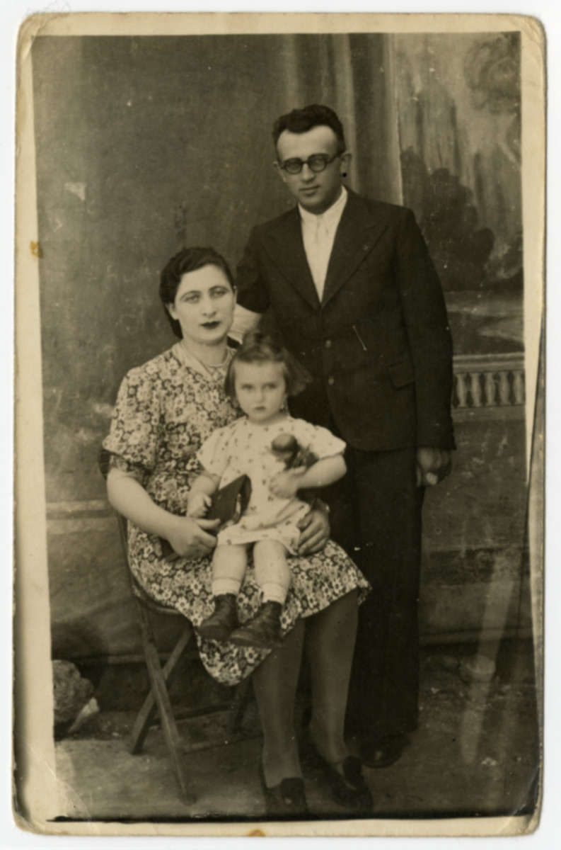 Studio portrait of  Mordechai, Feigele and their daughter (last name unknown).  The inscription on the back is dated 1941 but the photograph might have been taken before the war.