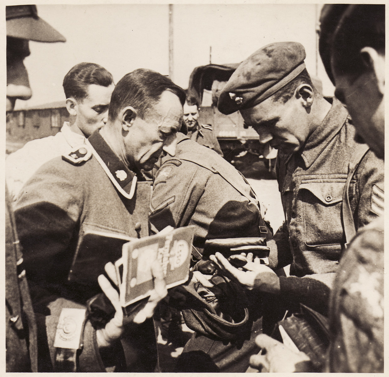 British soldiers inspect the documents of former SS guards at Bergen-Belsen concentration camp.