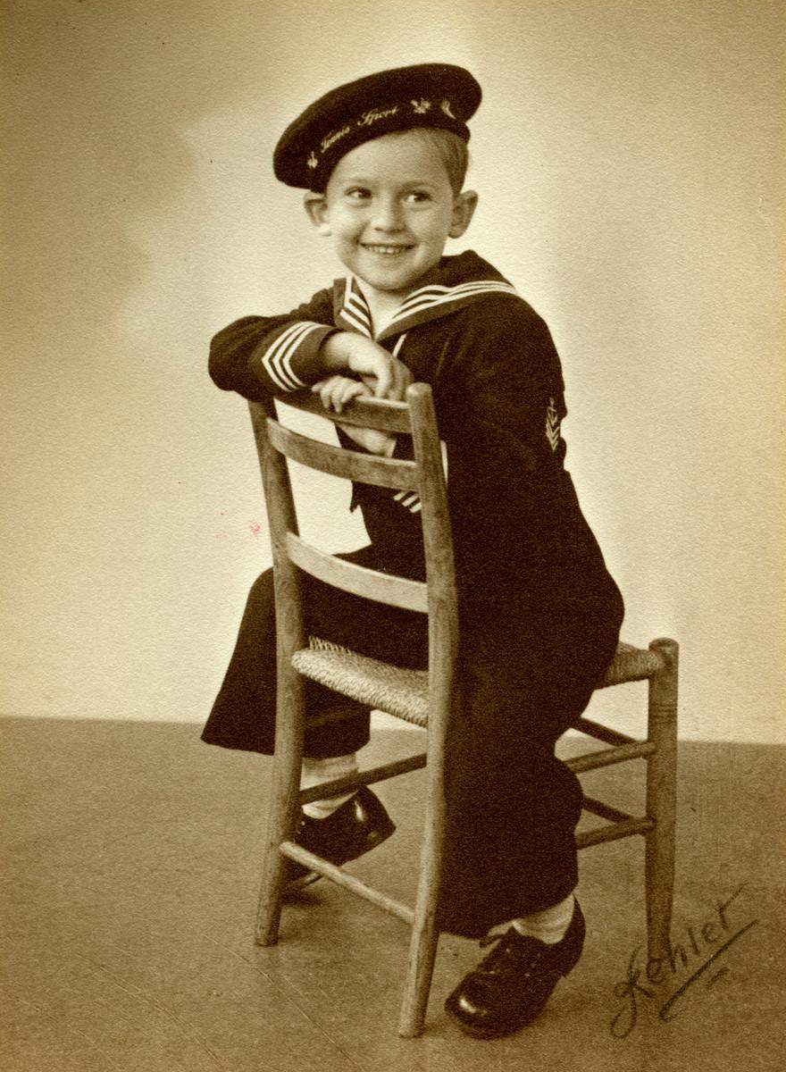 Postwar studio portrait of Zeev Jonas wearing a sailor suit.
