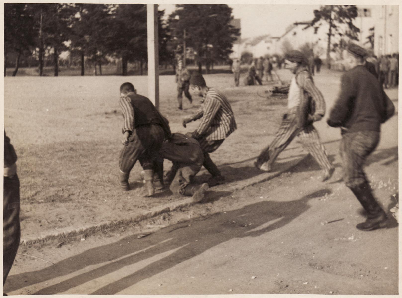 Survivors attack a former guard at Bergen-Belsen concentration camp.