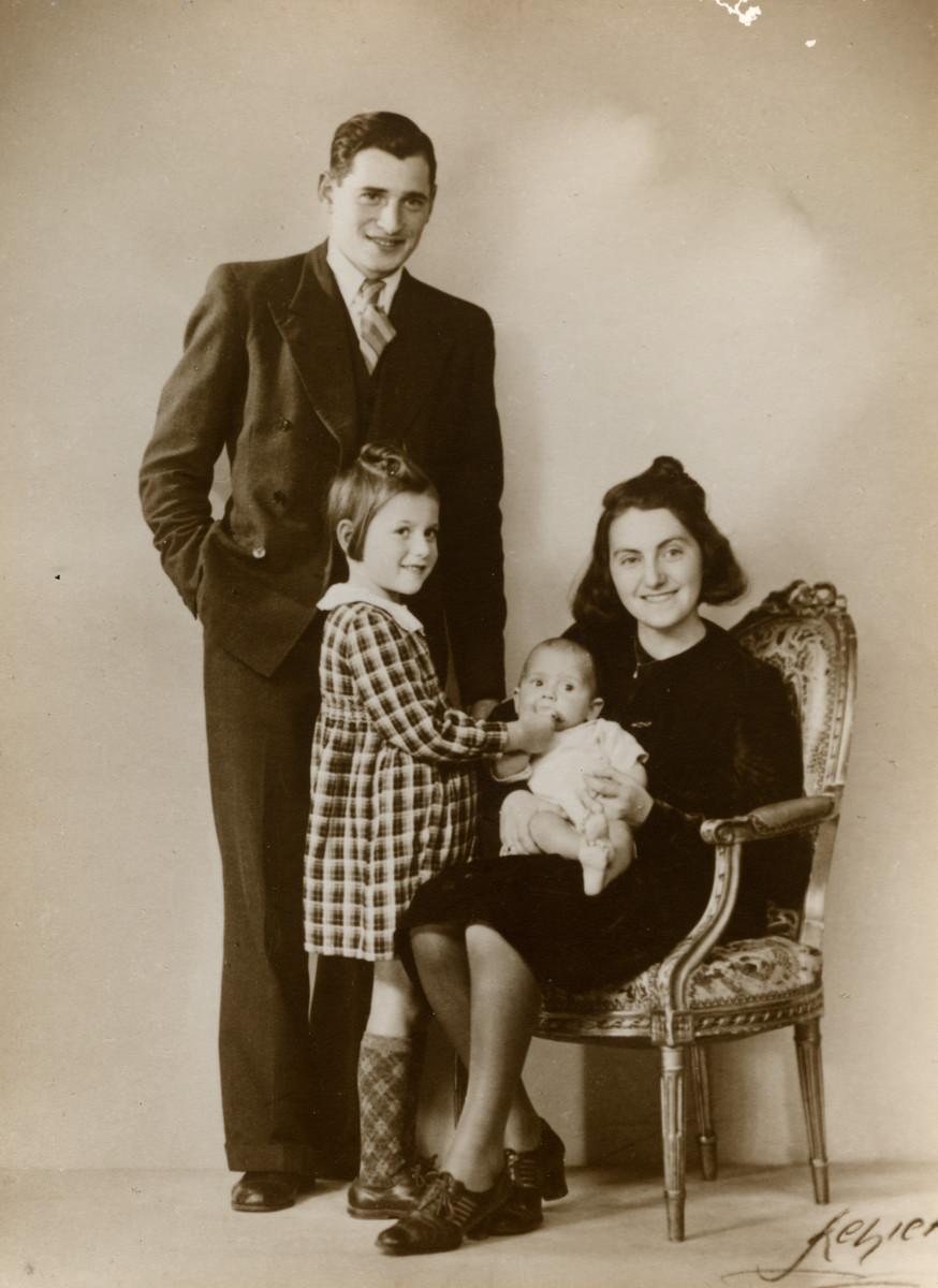 Studio portrait of the Jonas family in Copenhagen, Denmark.  Pictured are Anker and Devorah Jonas with their children Hennie and Zeev.
