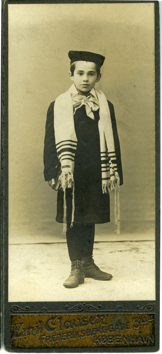 Bar mitzvah portrait of a Jewish boy in Denmark wearing a tallit; the child is a cousin of Bente Jonas.