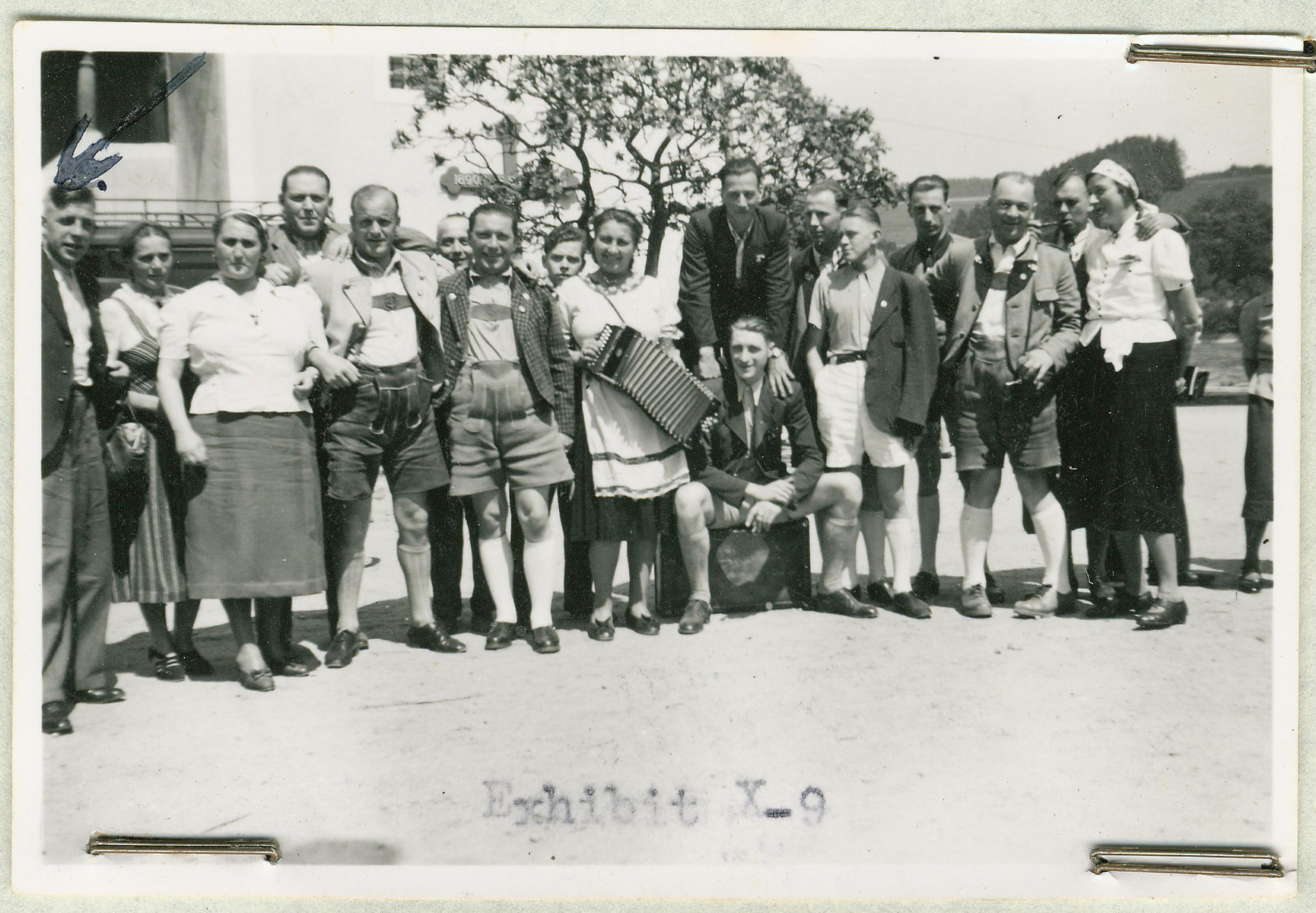 Group portrait of the staff of the Hartheim euthanasia facility relaxing with an accordion.
