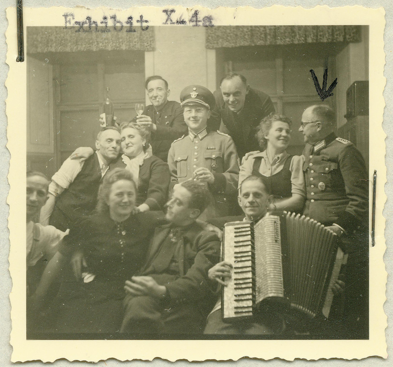 Group portrait of the staff of the Hartheim euthanasia facility relaxing with an accordian.