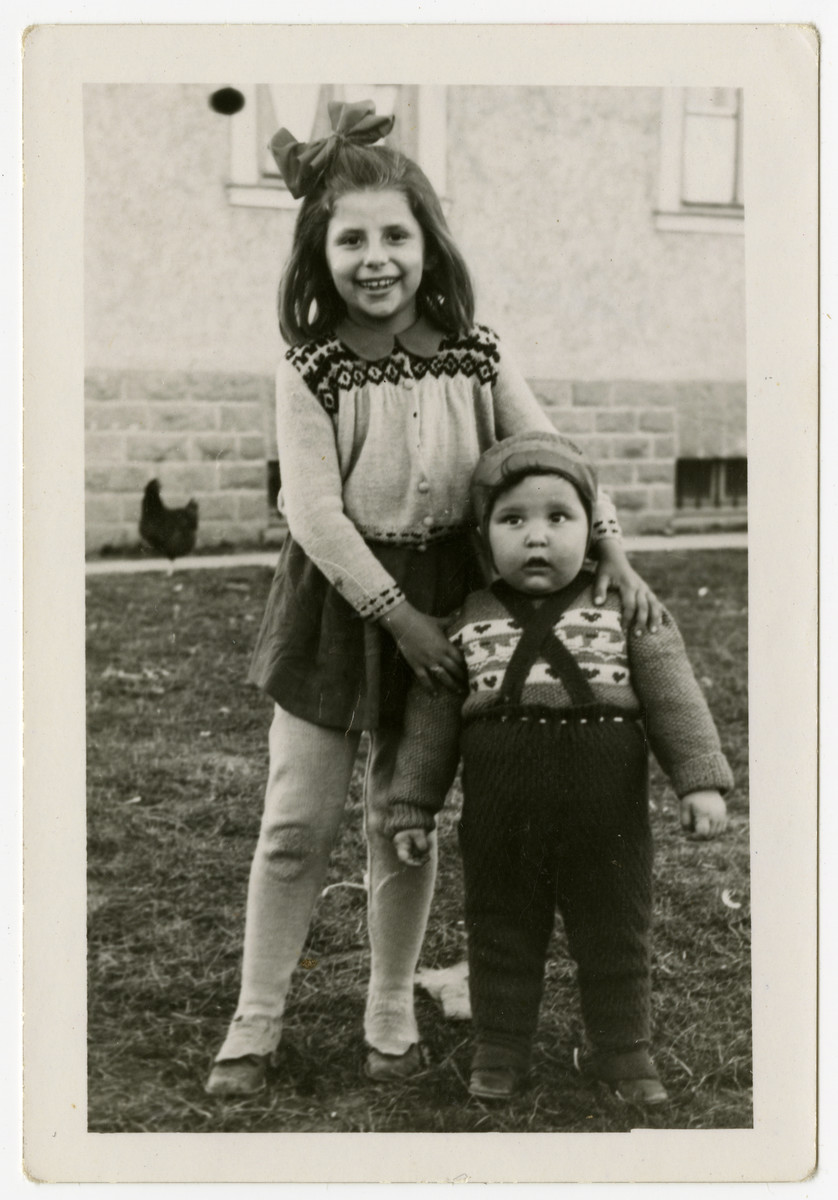 Moshe Sadik poses with an older girl in the Braunau displaced persons camp.