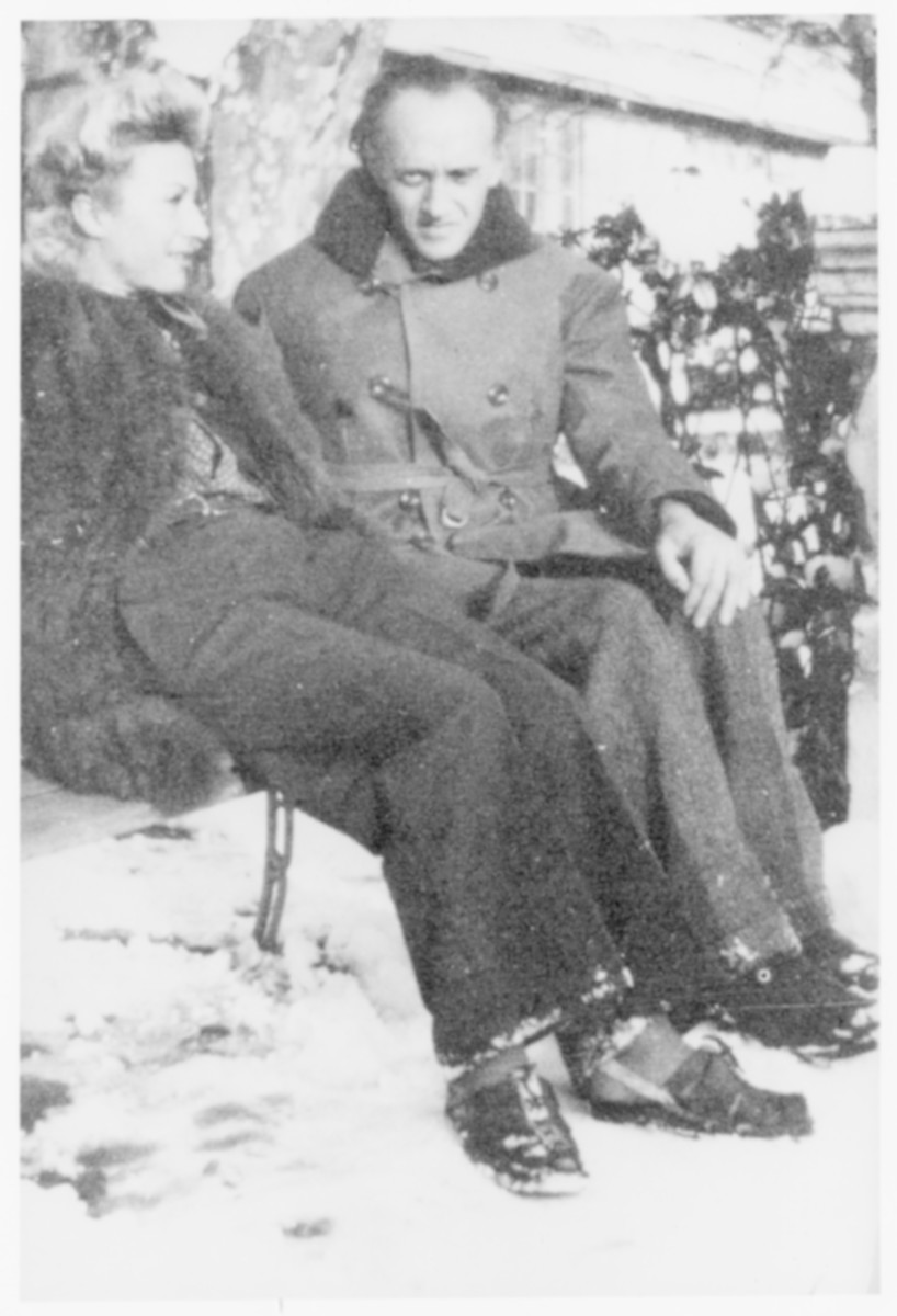 Jacqueline Lamba Breton and Victor Brauner sit outside on a bench at the Villa Air-Bel on a snowy day.