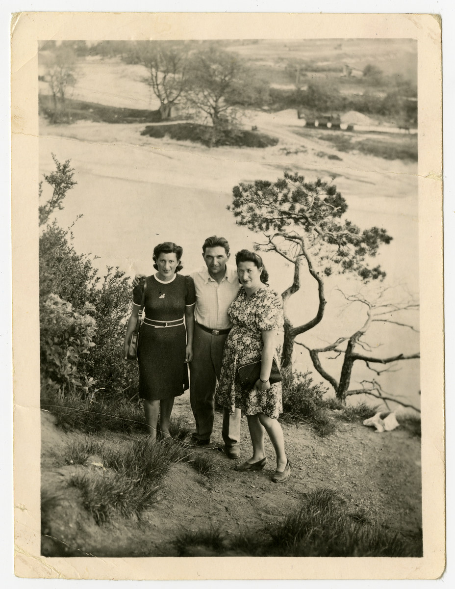 Three Jewish DPs stand on banks of either the Steyr or the Enns river.  Nachman and Miriam Sadik are on the right, and Miriam's cousin Czarna Kulas Zimmer is on the left.