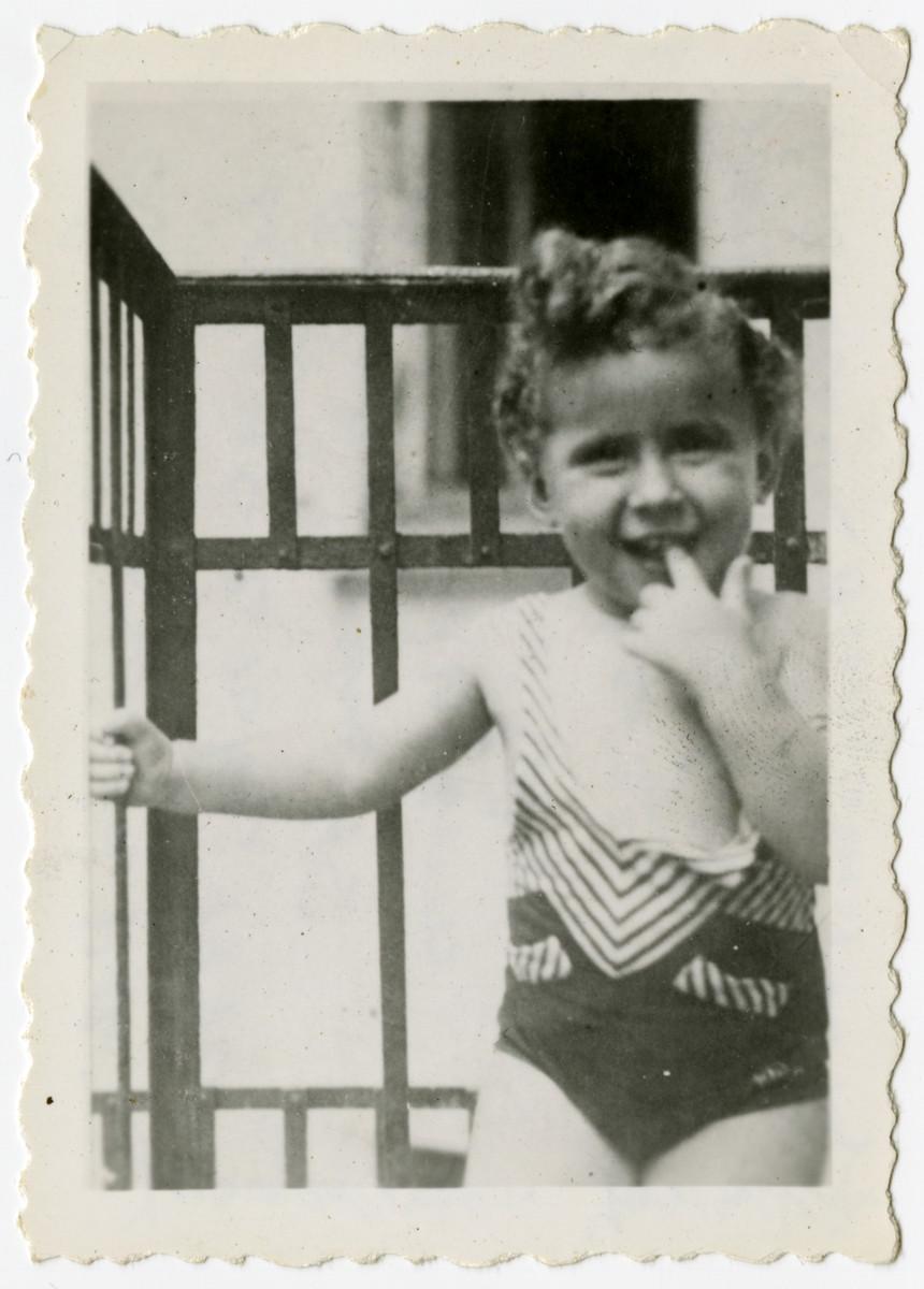 Close-up photograph of Lucynka Rutka Jungerman, (the donor's niece), on a balcony.  Lucynka Rutka perished in Treblinka in July 1942.