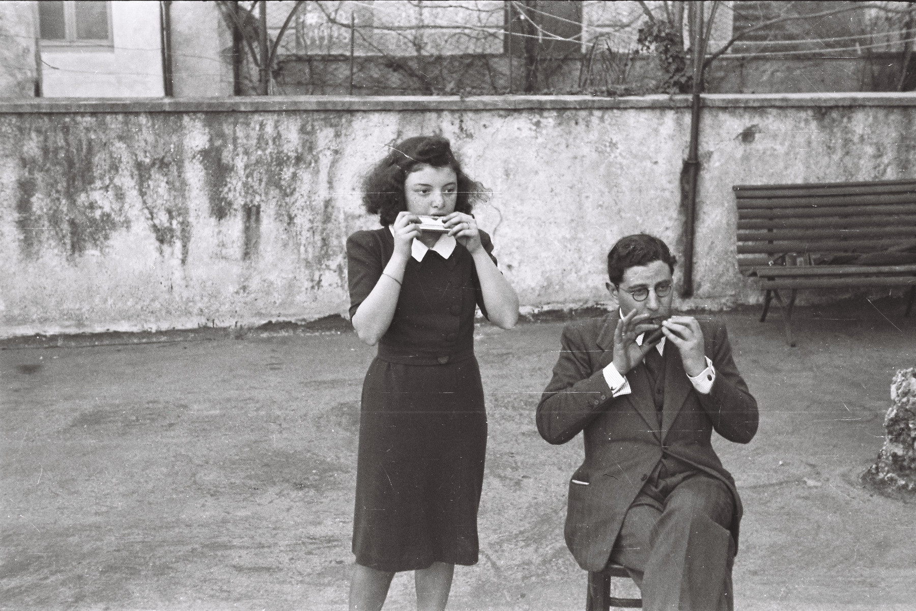 Nathan Cassuto and Anna Voghera play a duet on harmonicas in Cernobbio, near Lake Como.