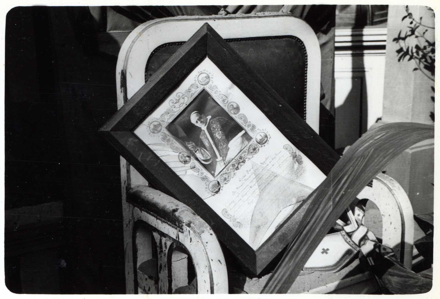 A portrait of Pope Pius XI is saved from a destroyed church in besieged Warsaw.