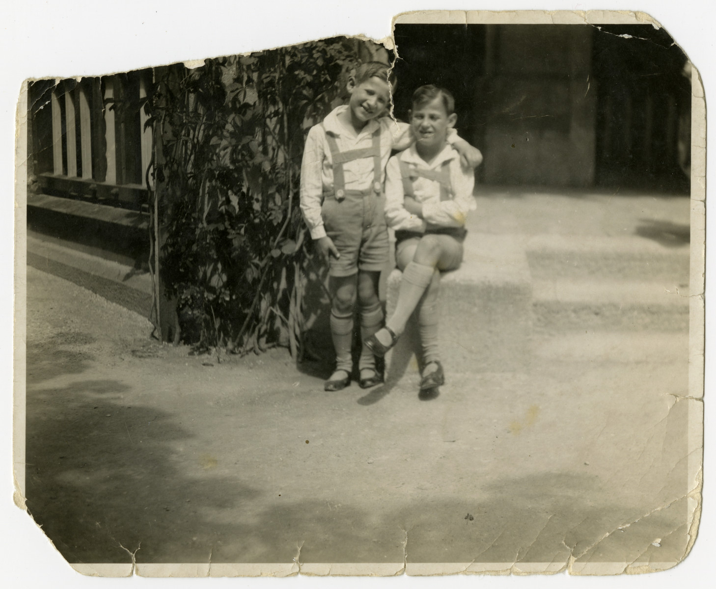 Portrait of Hans and Walter Gundelfinger wearing traditional German shorts.