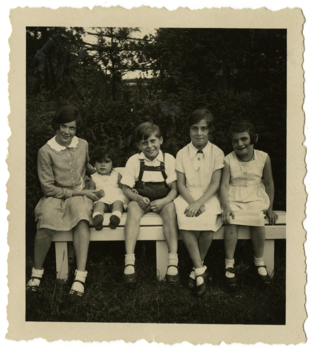 Children celebrate the second birthday of Inge Adler, a cousin of the Loeb girls.  Inge Adler second from left.  Clare Loeb second from right.  Hilde Loeb far right.