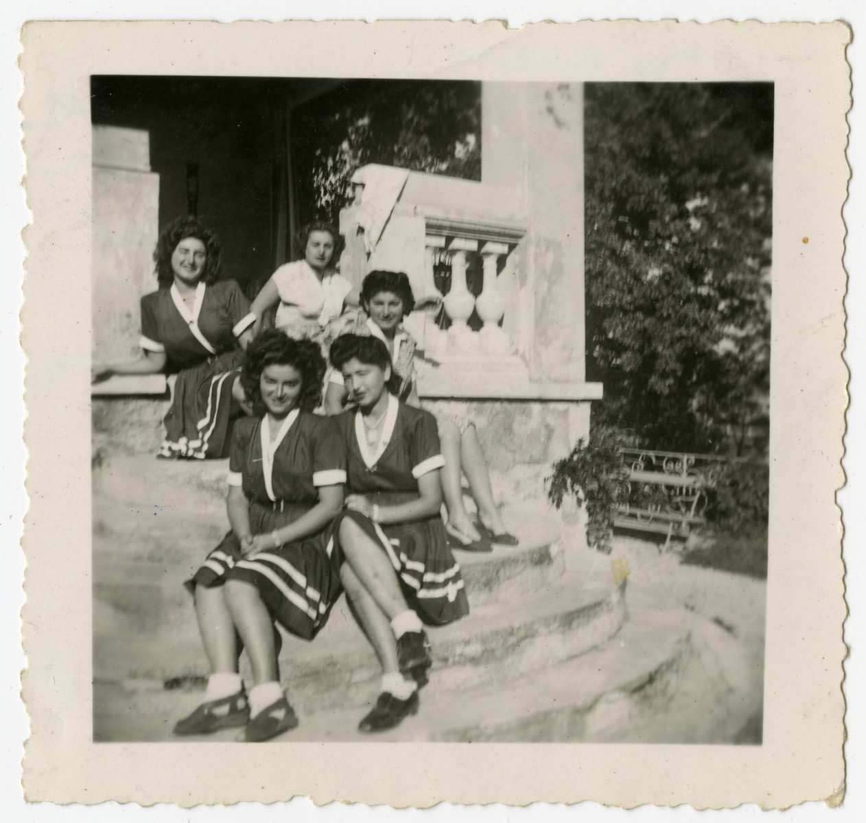 Five women sit together for a picture in Feldafing displaced persons camp.   Included are the four Herskovits sisters: Gizelle, Magda Vicky and Katya.