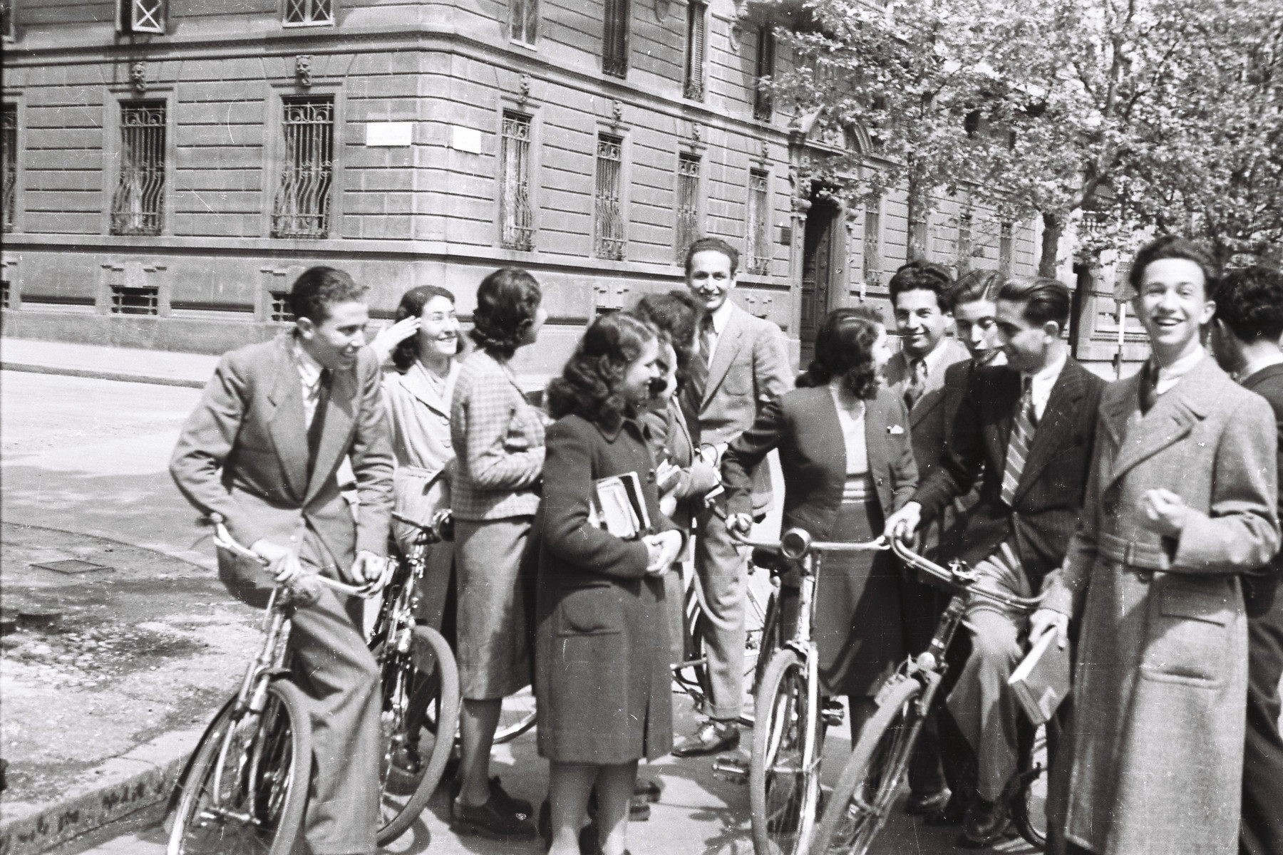 Students from the Scuolo via Eupili ride their bikes down the Via Canova while on a school trip.