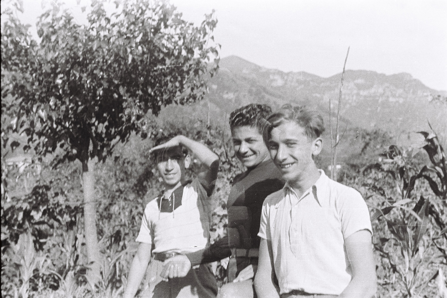 Cesare Vitale and two friends pose in a Zionist Hachshara near Milan.
