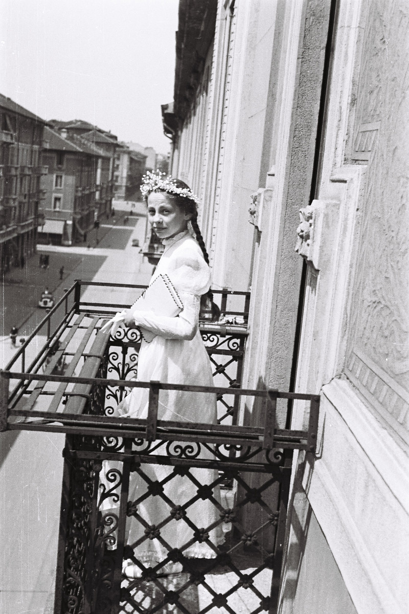 Graziella Falco poses on the balcony of her home dressed for her bat mitzvah.