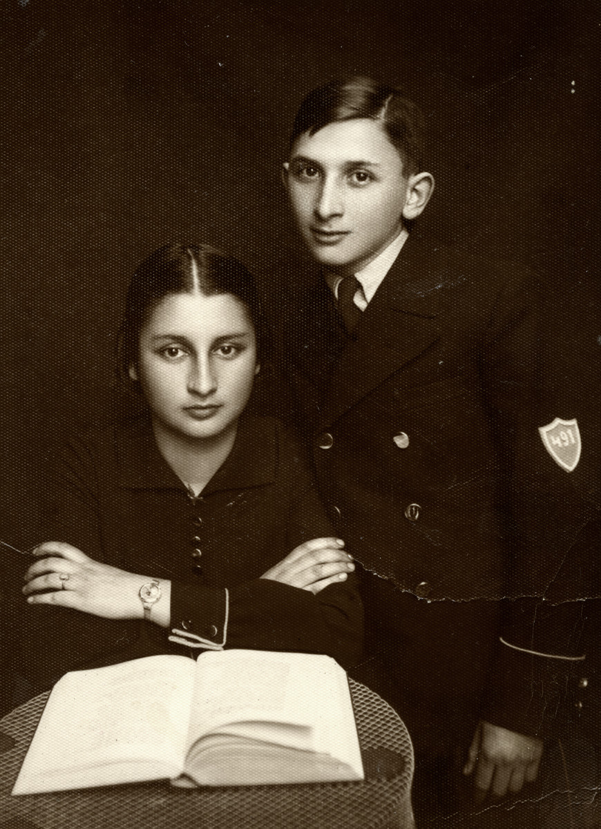 Studio portrait of Lonek (Leon) Halberstadt and his sister Yocheved (Jadza) on the occasion of his bar mitzvah,