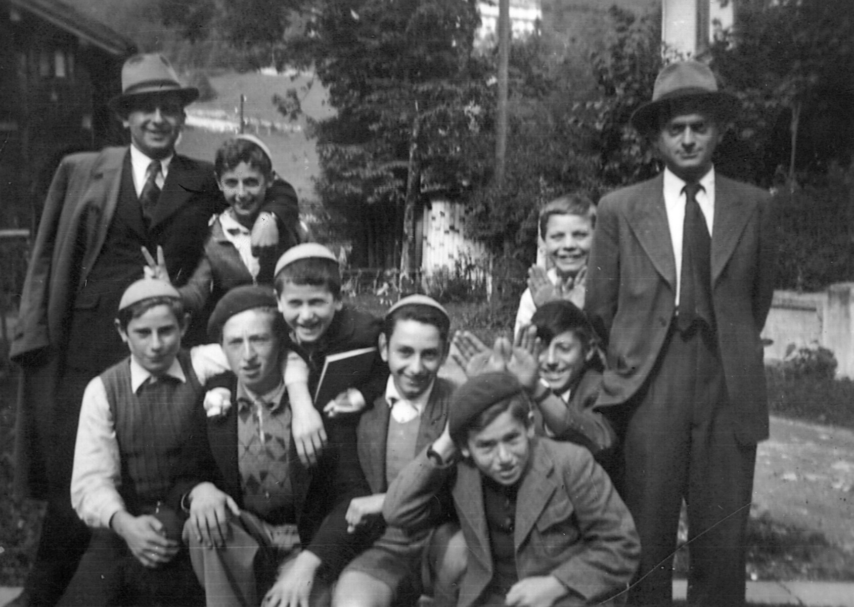 Group portrait of boys and teachers at the Orthodox Zionist Alijah Heim in Engelberg, Switzerland.   Among those pictured is Heinz Menachem Mayer.