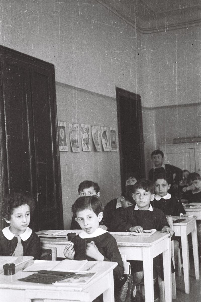 Children sit at their desks in a classroom in an elementary school in Milan.