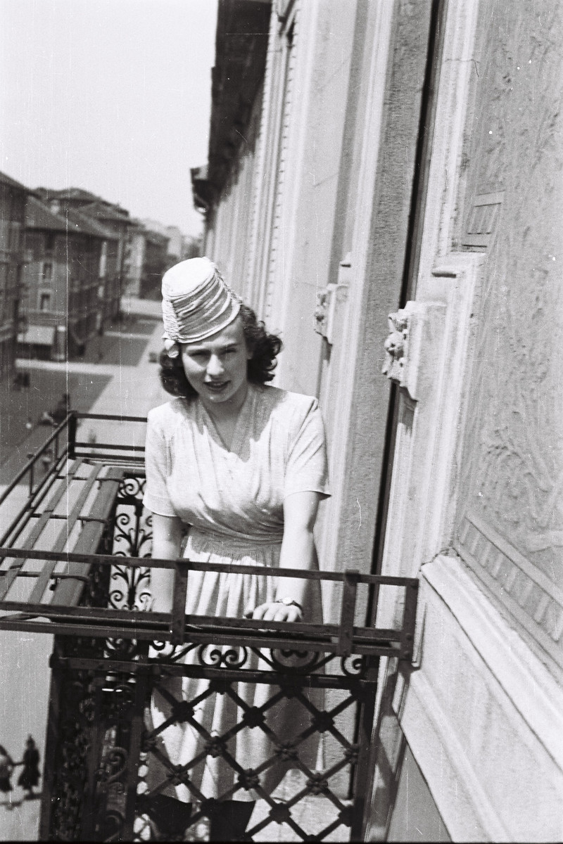 Anna Marcelo Falco poses on the balcony of her home dressed for her sister's bat mitzvah.