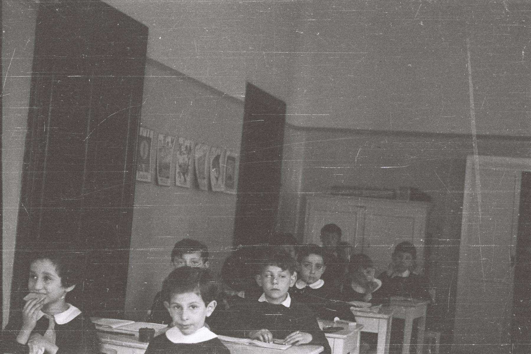 Children sit at their desks in an elementary school in Milan.
