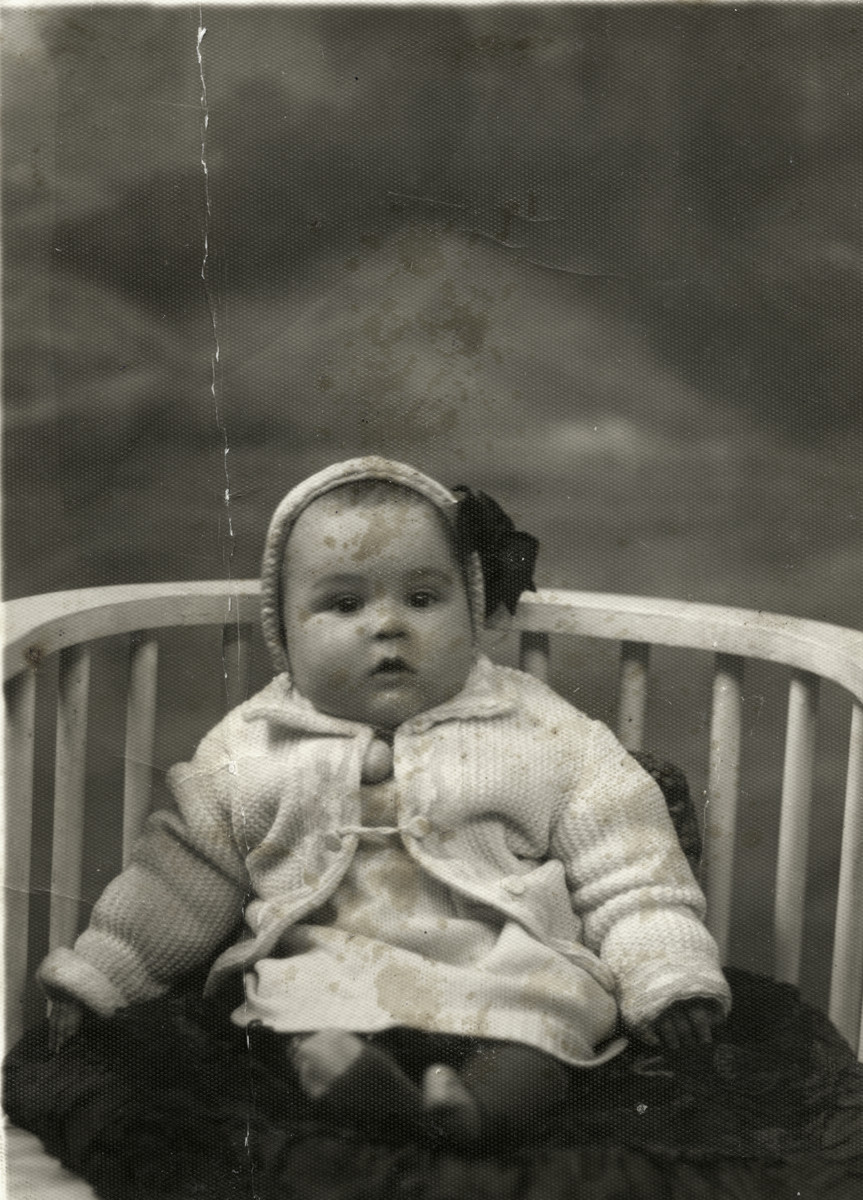 Studio portrait of a two month old Romanian Jewish boy, Binyamin (Benno) Aznel.
