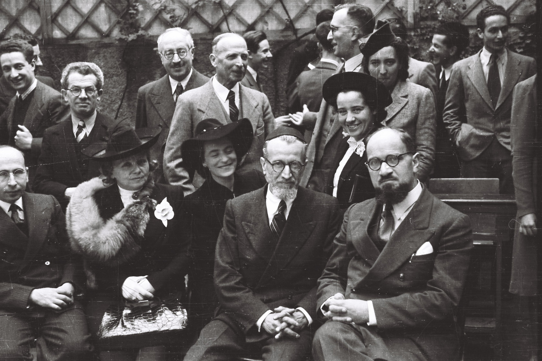 Group portrait of the faculty of the Jewish school in Milan, La Scuolo via Eupili.  Seated in the center is Rabbi Gustavo Castelbolognesi, chief-rabbi of Milan.  Alda Perugla is to his left and Prof. Columbo is seated to his right.  Hulda Cassuto (math teacher) is behind them and in-between Rabbi Castelbolognesi and Prof. Columbo.  Dr. Norsa, professor of philosophy is seated on the left and behind him is Professor Tedeschi.  Prof. Dreyfus is seated second from the left.